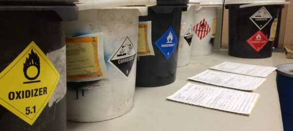 Hazardous waste storage containers with proper labeling